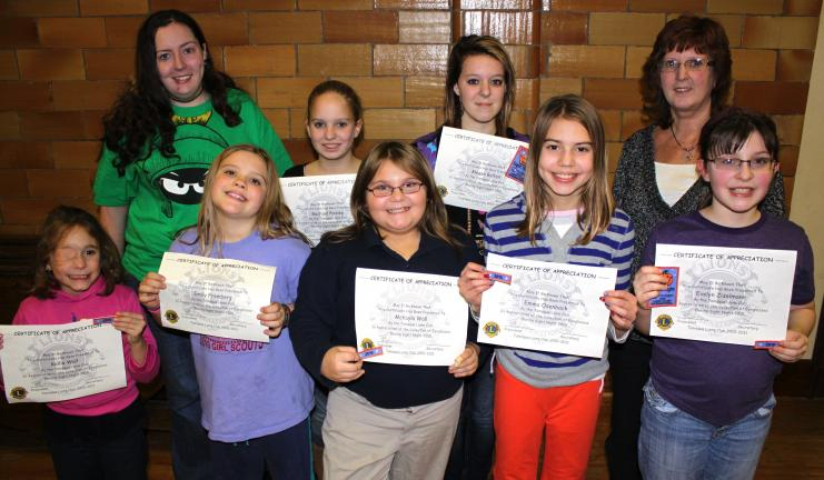 ANDREW LEIBENGUTH/SPECIAL TO THE TIMES NEWS Some of the girl scouts who participated, from front left, are Kallia Wall, Emily Fremburg, McKayla Wall, Emma Osenbach, and Evelyn Zizelmann. Pictured from back left are Tamaqua Lion Club Sight Night co…