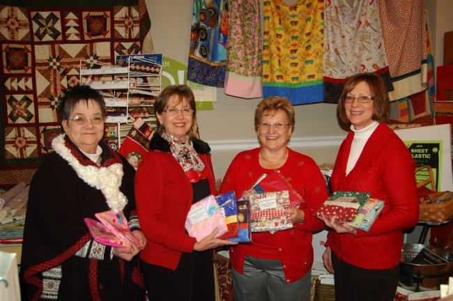 Carolyn's Quilt Shop, 109 E. Broad Street, Tamaqua, is participating in the One Million Pillowcase Challenge. Holding some of the 110 pillowcases made and collected by the shop are, from left, Linda Yulanavage, executive director, Tamaqua Area…