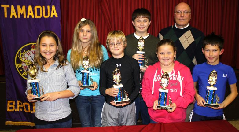 Andy Leibenguth/times news @Caption Stand Alone:Tamaqua Elks Hoop Shoot runner-ups Second place winners during the Tamaqua Elks 2010 Hoop Shoot were, front row, from, left are Mady Coccio, Riley McHugh, Emily Titus, and Derian Stianche. Back row,…