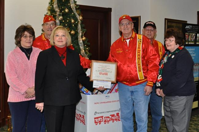 VICTOR IZZO/SPECIAL TO THE TIMES NEWS Mauch Chunk Trust Company employees donated toys and gave a monetary donation to aid the Toys for Tots campaign. Participating in the presentation were, left to right Diane Haberman, head teller; Joe Balogach;…