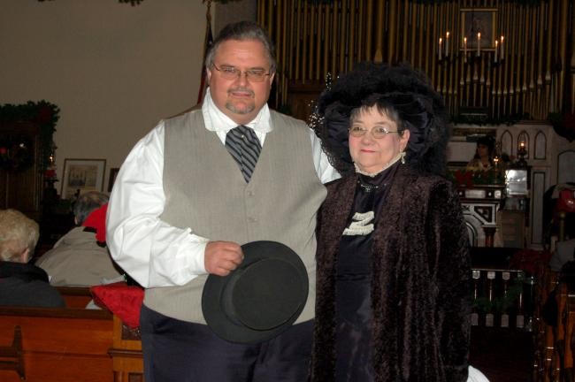 CHRIS PARKER/TIMES NEWS Dale Freudenberger and Linda Yulanavage portray a well-dressed Victorian couple at Lansford Historical Society's Victorian Christmas celebration Sunday.