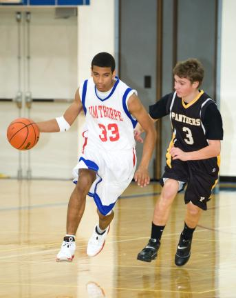 BOB FORD/TIMES NEWS Darius Clark (33) of Jim Thorpe brings the ball up court as Panther Valley's Mike Hadesty defends.