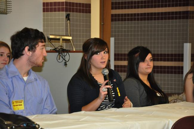AMY MILLER/TIMES NEWS Madeline Zurn, past president of the Lehighton National Honor Society and a freshman at Ursinus College, center, talks about time management at college during Monday's National Honor Society Winter Social at Lehighton High…