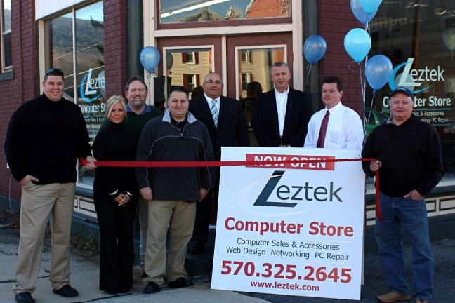 VICTOR IZZO/SPECIAL TO THE TIMES NEWS The new Leztek Systems computer store opened in Jim Thorpe at 434 Center Street. Pictured at the grand opening are, left to right : Mike Petrucci; Heather Skodacek, Office Manager; John MaGuire, JT Borough…