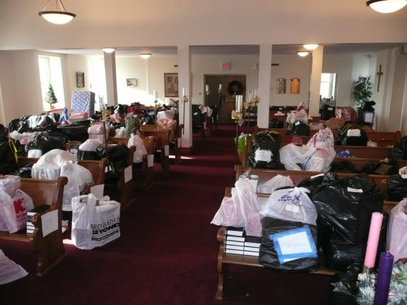 Special to the TIMES NEWS These pews inside Friedens United Church of Christ were filled with over 1,000 gifts prior to their delivery as part of the local Children's Christmas Gift Program administered by the church.