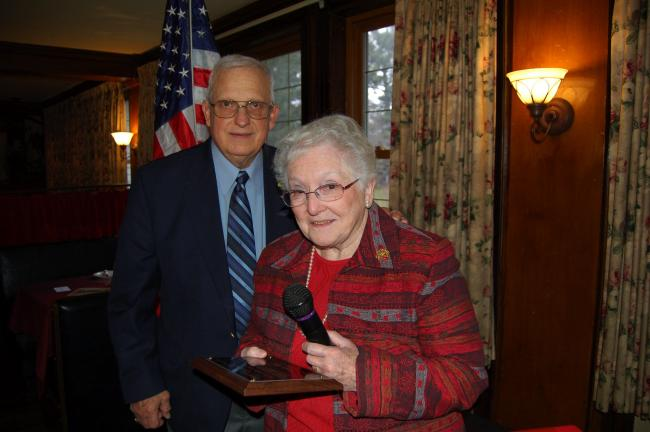 LINDA KOEHLER/TIMES NEWS Joe Horn, of the Young At Heart Senior Club, nominated Helen Bott for the Helen G. Brown Quality of Life Award. She received her award at the Monroe County Area Agency on Aging's RSVP luncheon.
