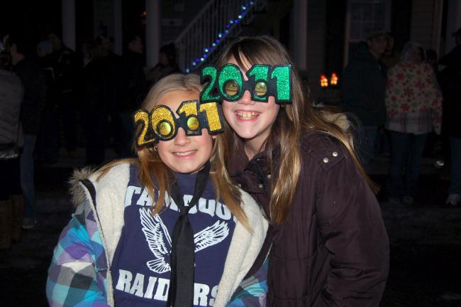 "JOE PLASKO/TIMES NEWs Ashley Hartranft and Hayley Martin, both 11, of Tamaqua show off their ""2011"" glasses at the New Year's Eve Eagle Rise."