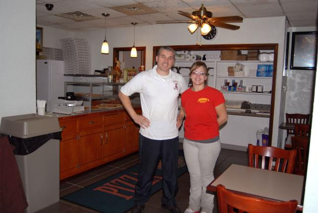 Ron Gower/TIMES NEWS Johnny Krasniqi and his daughter, Vanessa, stand inside Johnny's Restaurant and Pizza II, 111 N. First St., Lehighton. Krasniqi said he spent about $180,000 on a renovation project that took over a year to convert the former…
