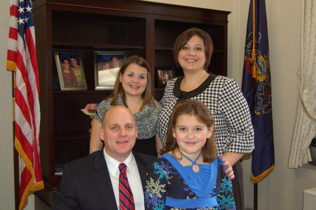 VINNY VELLA/TIMES NEWS Doyle Heffley, seen here with his wife Kelly and his daughters Elizabeth (back) and Angela, christened his new Harrisburg office shortly before Tuesday's swearing-in ceremony.
