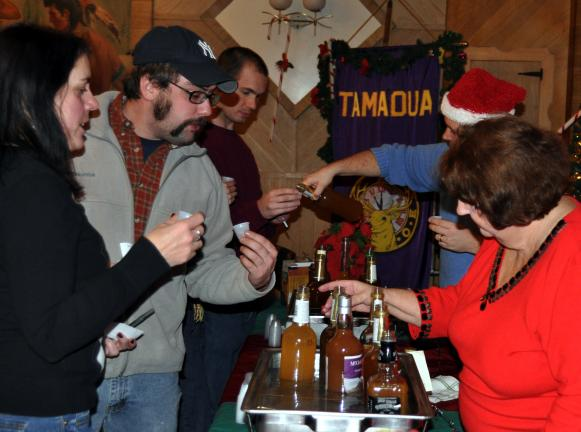 DONALD R. SERFASS/TIMES NEWS Taste-testers line up to sample varieties of boilo during the Seventh Annual Tamaqua Boilo Competition held at the Tamaqua Elks and sponsored by Dave and Judy Johns and family.