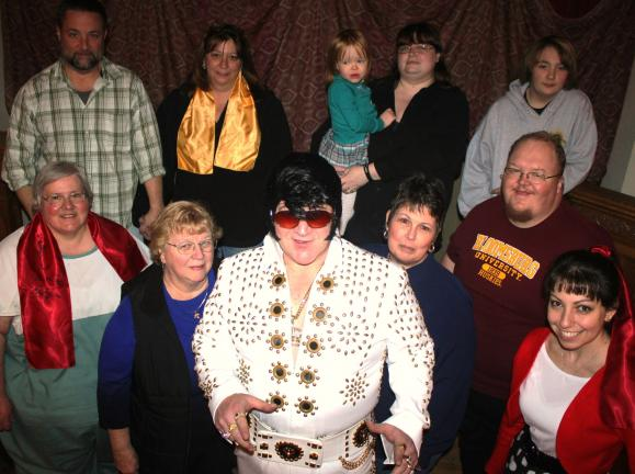 "ANDREW LEIBENGUTH/SPECIAL TO THE TIMES NEWS Summit Hill Heritage Center volunteers and board members pictured with Elvis impersonator ""Johnny M"" from front left are President Deb Ranck, treasurer Elenora Clay, performing artist and singer ""Johnny M""…"