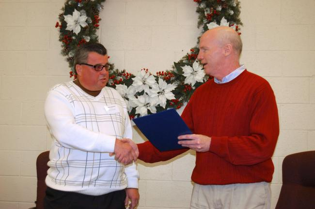 JOE PLASKO/TIMES NEWS U.S. Representative Timothy Holden (D-17) presents a Congressional citation in honor of Rush Township's 200th Anniversary to Supervisors Chairman Stephen W. Simchak, left.