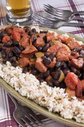 AP Photo/Larry Crowe  A simmering pot of stew is just right for a cold winter night and this Black Bean and Spicy Sausage Stew over Brown Rice will heat you up without taking too much time in the kitchen.