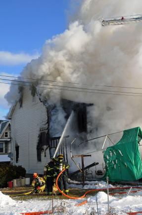 Larry Neff/special to the times news Firefighters pour water into the home during Thursday morning's fire in Slatington.