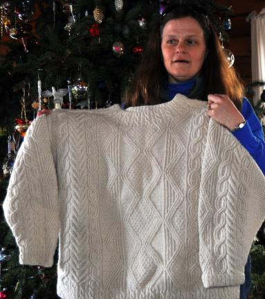 DONALD R. SERFASS/TIMES NEWS  Cathy Riotto, Barnesville, displays the fisherman's sweater she created from scratch, a garment that launched the Holly Road Fiber Farm.