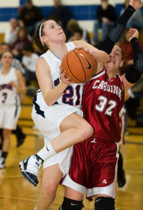 bob ford/times news Brittany Holland of Jim Thorpe goes strong to the basket against Pine Grove's Alicia Kimmel.