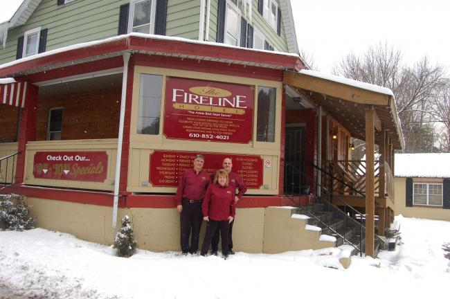 TERRY AHNER/TIMES NEWS  Pictured outside of the Fireline Hotel in Palmerton are (front) Jane Hower (back, l-r) Ken Huber and Michael DiGirolamo. The restaurant recently celebrated its five-year anniversary.