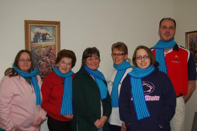 LINDA KOEHLER/TIMES NEWS The Palmerton Library Knitting Club completed 38 scarves to be donated to the 2011 Pennsylvania Special Olympics Winter Games athletes as part of the Special Olympics USA Scarf Project. Some of the knitters are modeling the…