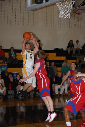 Panther Valley's Zach Stanko (5) goes up with a jump shot during overtime. Jim Thorpe's J.T. Otto is the defender.