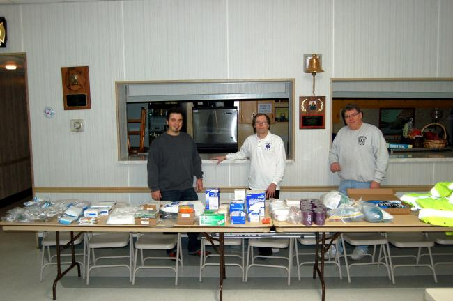 Gail Maholick/TIMES NEWS Franklin Township Quick Response Squad (QRS) display the items purchased with a $1,000 donation from the Franklin Township Lions Club. From left are Rob Bergstresser, Tom Chew and Bob Mertz, captain.