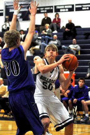 mike feifel/times news Lucas Pierce of Northern Lehigh (50) gets ready to go up with a shot as Aaron Rockel defends.