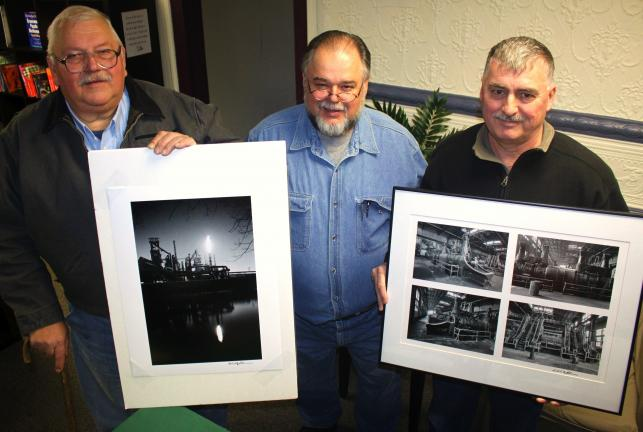 "ANDREW LEIBENGUTH/SPECIAL TO THE TIMES NEWS ""30 Years Under The Beam"" book author Frank Behum Sr. presented two framed photos, by artist Ed Leskin, originating and representing official photos from the steel workers' archives to two local persons…"