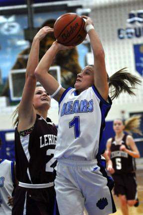 mike feifel/times news Pleasant Valley's Kasey Meckes (1) goes over Lehighton's Kenzi Teno.