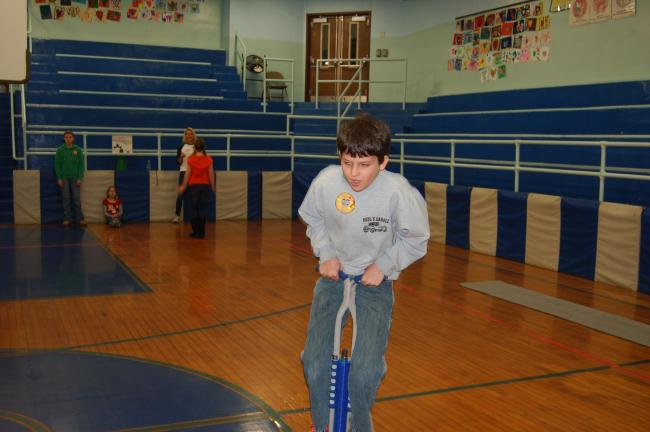 TERRY AHNER/TIMES NEWS S.S. Palmer Elementary student Kyle Strohl does his best on the pogo stick in an effort to raise money as part of the Jump Rope for Heart program.