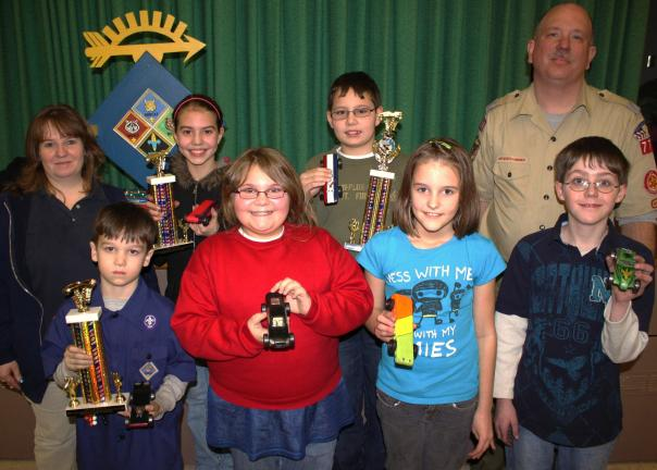 ANDREW LEIBENGUTH/SPECIAL TO THE TIMES NEWS Pictured from back left are Tamaqua Girls Scouts service unit manager Nancy Paisley, third place winner Emma Osenbach, 12, first place winner Nathan Steigerwalt, 11, and Tamaqua Boys and Cub Scouts unit…