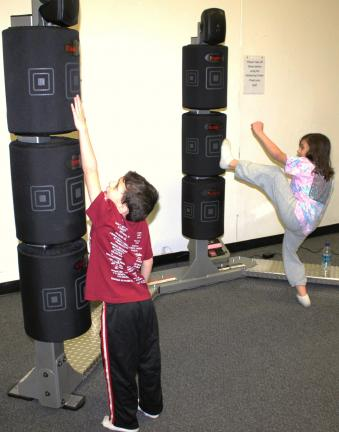 ANDREW LEIBENGUTH/SPECIAL TO THE TIMES NEWS Trying out the new kickboxing tower are siblings Derek, 6, and Ashley DeAngelo, 10.