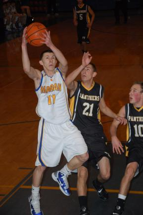 RON GOWER/TIMES NEWS Marian's Chris Barletta (11) pulls down a rebound in front of Panther Valley's Joe Dalessio.