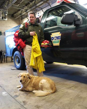 AL ZAGOFSKY/SPECIAL TO THE TIMES NEWS Wes Keller, forest fire specialist supervisor DCNR-Forestry at the Penn Forest Fire Control Station with Dudley, a Golden Retriever being trained for search and rescue. Keller holds specialized wildfire personal…