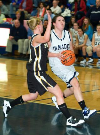 BOB FORD/TIMES NEWS Tamaqua's Cassie Eroh drives to the hoop as Panther Valley's Mary Jane Thomas moves in to defend.