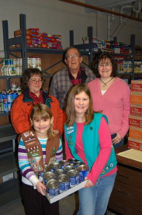 LINDA KOEHLER/TIMES NEWS Karyn Thomas, front row, left, a Brownie of Troop 3112 and Bethany Thomas, right, a Junior Girl Scout of Troop 3112, help deliver 1,210 cans and packages of soup from the Palmerton Area Girl Scout Souper Bowl of Caring…