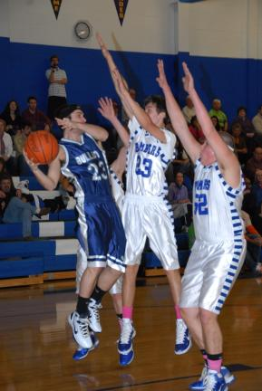 RON GOWER/TIMES NEWS Northern Lehigh's Josh Malaska (23) looks for help as Palmerton's Kyle Ruch (23) and Jourdan Reinhart (52) double team him.
