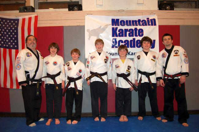 Gail Maholick/TIMES NEWS Mountain Karate Academy tested five students for black belt status. From left are, Rich Maglionico, instructor; Josh Johnson, Shawn Truhe, Paige Steigerwalt, Zander Karpowicz, Anthony Maradeo; and Master Paul Maglionico.