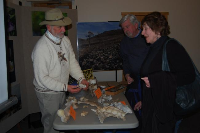 ELSA KERSCHNER/TIMES NEWS Tom and Kathy Woodley listen as Bud Cole talks about some of the bones he brought.