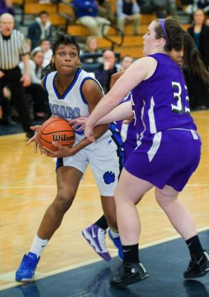 BOB FORD/TIMES NEWS Pleasant Valley's Kalecia Harris (left) pulls the ball away from East Stroudsburg South's Tara Steakin.