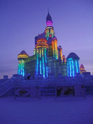 As night descended, the lights within each ice block that formed the foundation, walls and spires of the buildings were illuminated in an aurora borealis of colors.