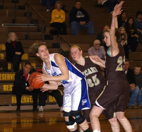 LINDA ROTHROCK/Special to THE TIMES NEWS Palmerton's Kelsey Hay leans back as she looks for a teammate and tries to avoid a double-team from Bethlehem Catholic's Caitlin Kessler (35) and Shannon Smith (right).