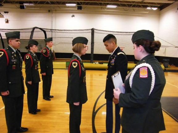 CAROL ZICKLER/SPECIAL TO THE TIMES NEWS Lehigh University active Army inspects JROTC cadet Courtney Lazar.