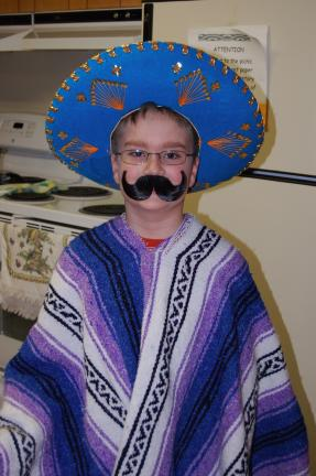 "Matthew ""Chili the Kid"" Binder is a colorful ""Mexican"" who got a lot of attention. His sombrero came from Mexico and the serape was made for a Halloween costume."