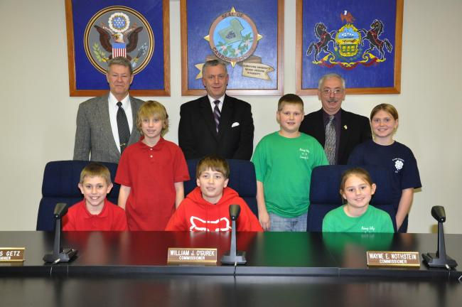 AMY MILLER/TIMES NEWS Members of the Carbon County 4-H get the opportunity to thank Carbon County Commissioners Charles Getz, William O'Gurek and Wayne Nothstein, standing. Representatives of the 4-H clubs are, seated, from left, Cobe Frycklund,…