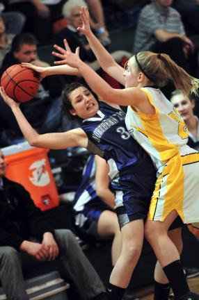 NANCY SCHOLZ/TIMES NEWS Kelsey Follweiler of Northern Lehigh (left) is pressure by Bishop McDevitt's Julie Kostic.
