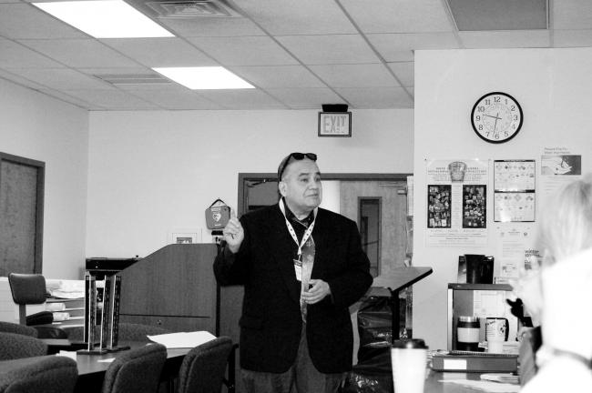 CHRIS PARKER/TIMES NEWS Oscar Santizo, employment specialist with Human Resources Center Inc., Stroudsburg, talks to representatives of Carbon County service agencies Thursday.