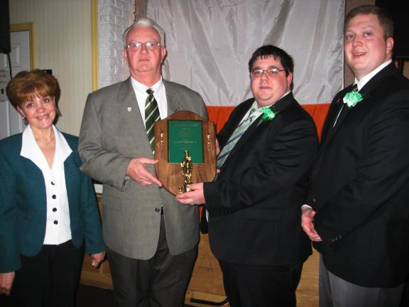 BILL O'GUREK/TIMES NEWS Rep. Jerry Knowles, second from left, accepts the Shamrock Award from Panther Valley Irish-American Association President Daniel McAndrew, second from right, during the 64th Annual Banquet held Thursday night in Lansford…
