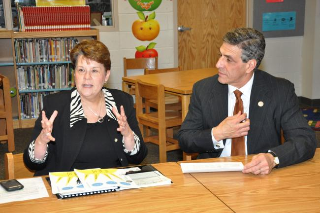 Jeanne Miller, director of the SHINE after-school program, left, talks with United States Congressman Lou Barletta, right, and members of his staff about the importance of continuing funding for programs such as SHINE. Miller, as well as Carbon…