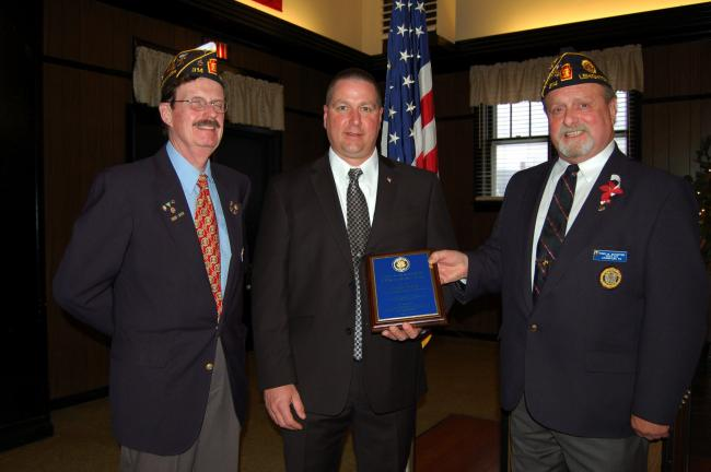 Frank Lorah, center, was named the Law Enforcement Officer of the Year at the Lehighton American Legion Post 314. From left are Harry Wynn III, finance officer; and Fred Schaffer, commander, right.