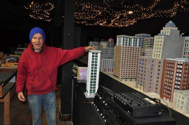 RON GOWER/TIMES NEWS Rev. Joseph Kean of Cherryville, retired priest and former pastor of Ss. Peter and Paul Catholic Church in Lehighton, looks over buildings which will be part of a huge model train display in Allentown.