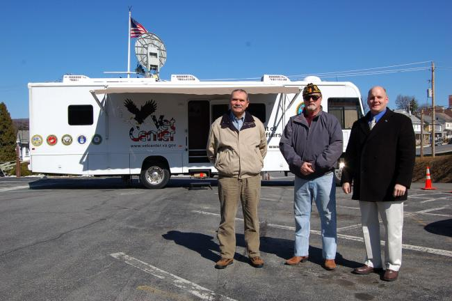 Gail Maholick/TIMES NEWS Dennis McCaig of Jim Thorpe, left, a Marine Corps veteran of Vietnam, was one of the first 20 veterans to visit the Mobile Veterans Center van at the Lehighton American Legion Post. From left are McCaig, Fred Shaffer,…